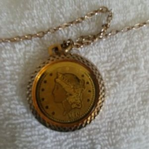 A $20. Centennial Dollar piece made into a necklac